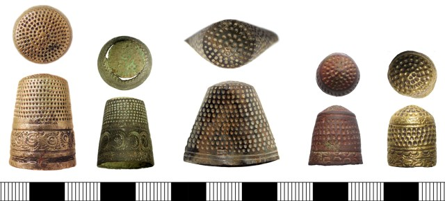 16th-century thimbles with decoration below a right-hand spiral of indentations. From left: LON-6EDF95, SUR-AE7296, PUBLIC-22CAF2, PUBLIC-647D74, and PUBLIC-2E1F38 (a more heavy-duty thimble). Some have makers' marks, others do not.