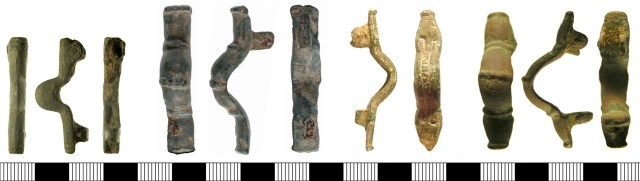 Ansate brooches of Weetch's type X. Left to right: SF-42D433 (type X.Ai, with parallel sides and undecorated), KENT-918A91, (type X.Aii, with parallel sides and transverse ribs) LIN-DFE605 (type X.B, with animal head decoration), SF-77B7A1 (type X.C, with bulging sides and transverse ribs).