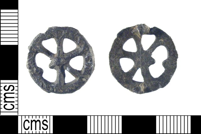 Late medieval pilgrim badge in the shape of a Catherine Wheel.