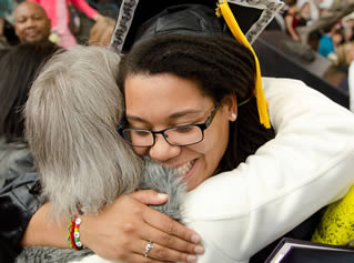 happy-college-graduate-hugging
