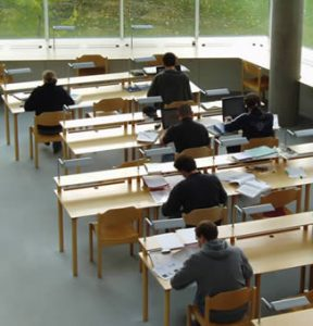 students-at-college-working-on-assignment
