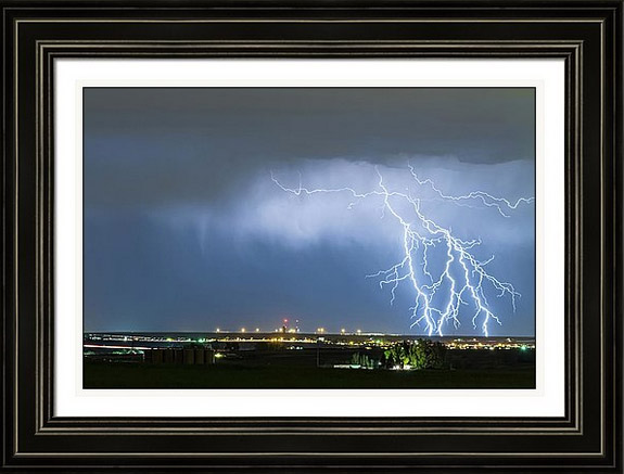 Northeast Colorado Lightning Strike And City Lights Framed Print