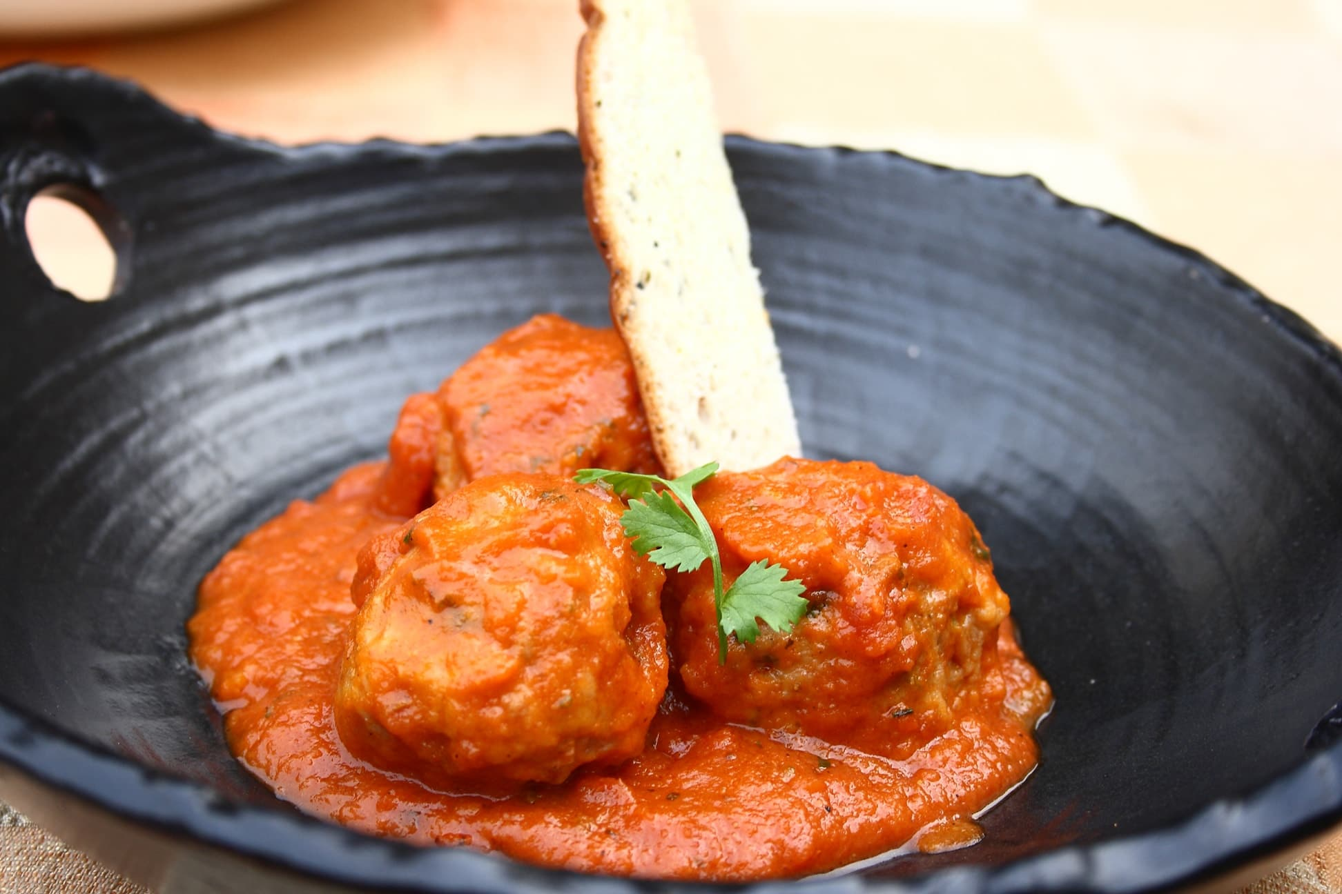 chicken tikka meatballs, chopped tomato makhani-min