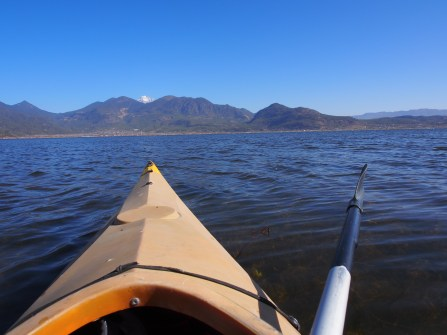 My kayak pointing due north, straight at the Jade Dragon Snow Mountain.