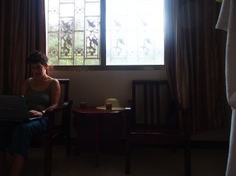 Naima in our super odd hotel room.