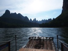 Mountains, fake bamboo boat, the roar our motor and the other 100 boats... ah, serenity now!