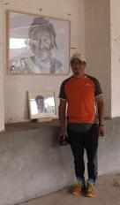 Mu Yun Bai next to his work.