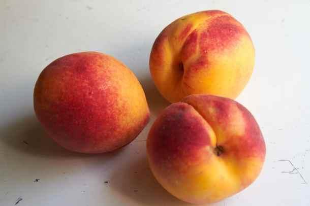 Three whole peaches