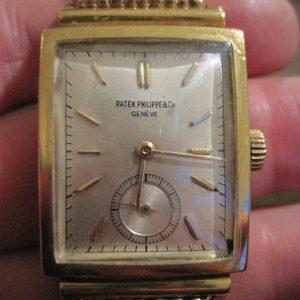 Gold Patek Philippe Tank Watch