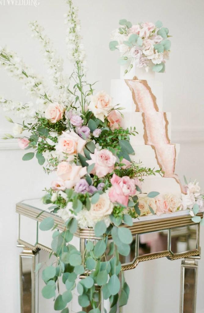 Romantic Garden pastel wedding cake with wedding flower arrangement on art deco table in Toronto Canada