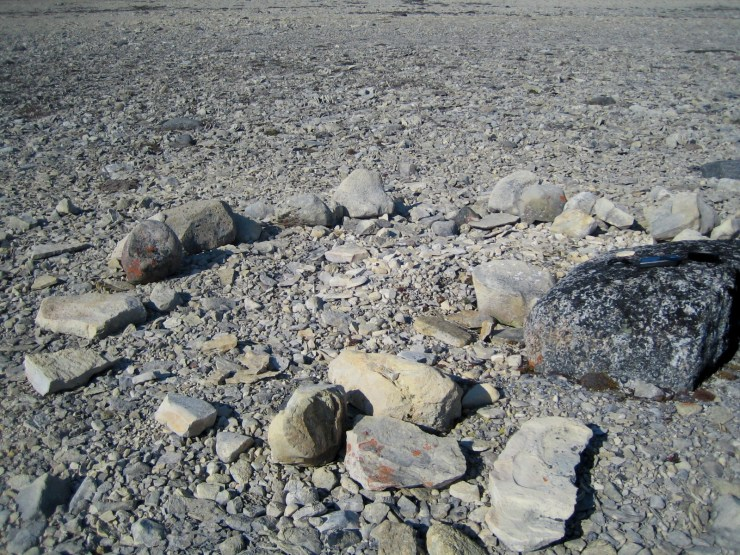 The remains of a stone cairn.