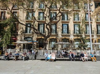 People enjoying the spring sun in Barcelona
