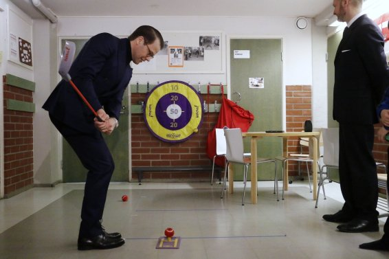 Prince Daniel grabs a golf club for some indoor activity. Picture: Tony Öhberg for Finland Today