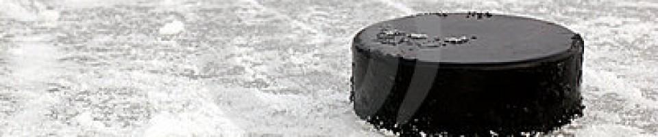 cropped-black-hockey-puck-ice-rink-8016165.jpg