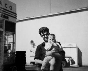 Photo of John Servis holding Kevin Finn, 1969