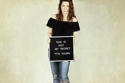 woman holding signage