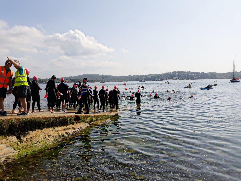 triathletes enter the water at schull triathlon