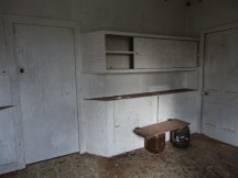 The once glamourous new cupboards filled with treats and precious ingredients - the shops are too far just for a cup of flour or sugar.