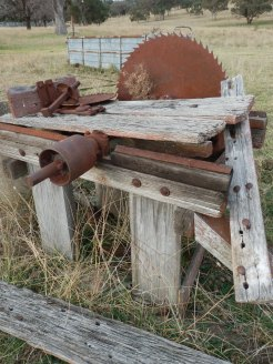 Once a valuable trimmer of timber with the belt drive driven by the tractor.