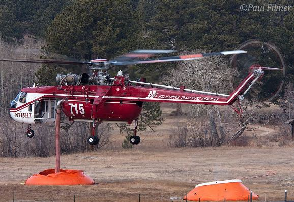 """Air-Crane drafting water from a """"pumpkin"""" on the Fern Lake Fire, Photo by Paul Filmer"""