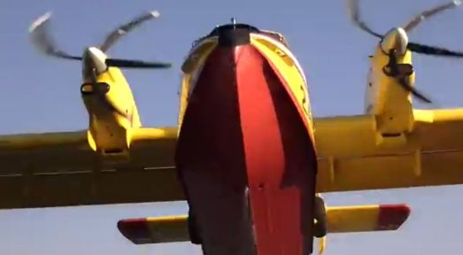 Video of CL-415s scooping, up close and personal