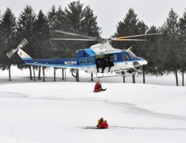 NPS helicopter rescues man and two dogs from icy lake