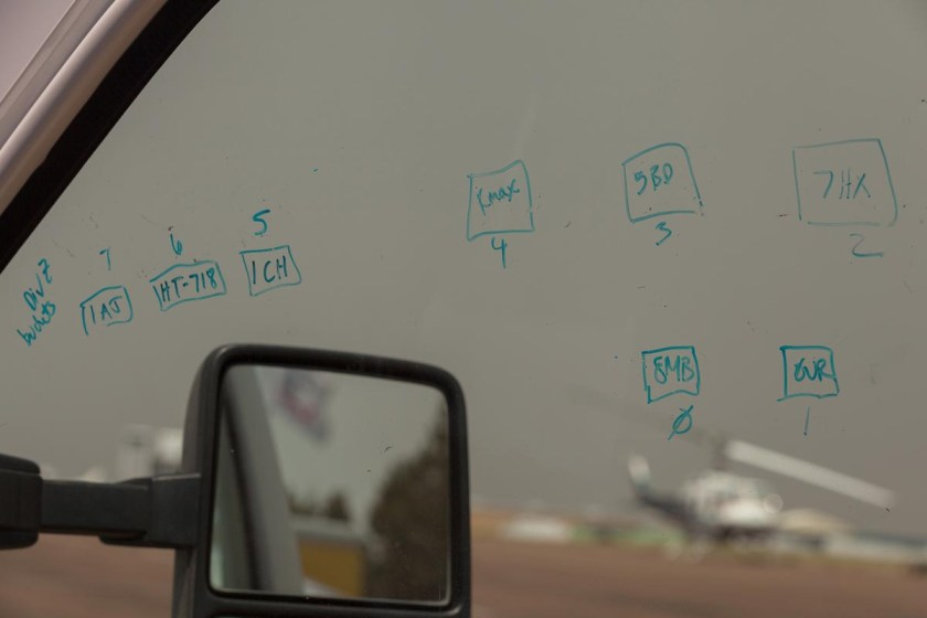 The passenger side window of Durango Helitack's vehicle was pressed into service as a writing surface, showing a diagram of the helibase deck at Show Low, AZ airport for helicopters staged for IA and in support of the Cedar Fire on the White Mountain Apache Reservation.