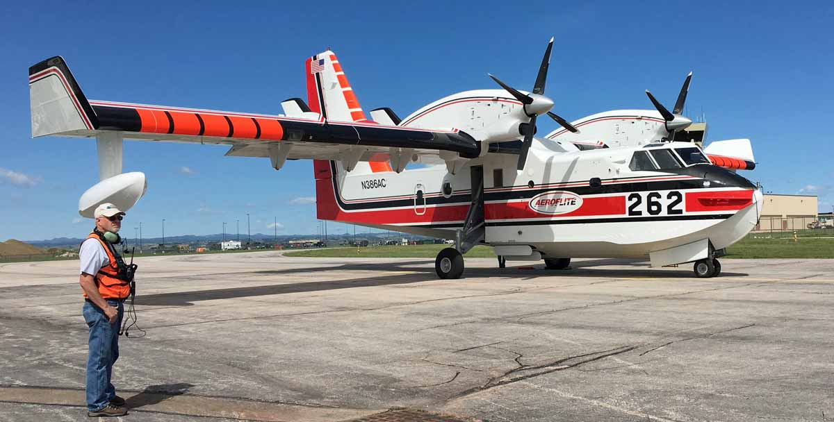Two scooping air tankers positioned at Rapid City