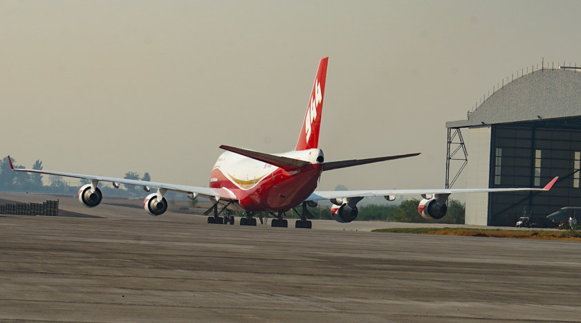 Two aircraft are working with the 747 SuperTanker