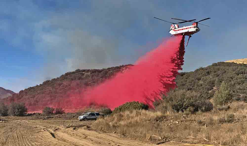 Retardant from a helicopter's internal tank