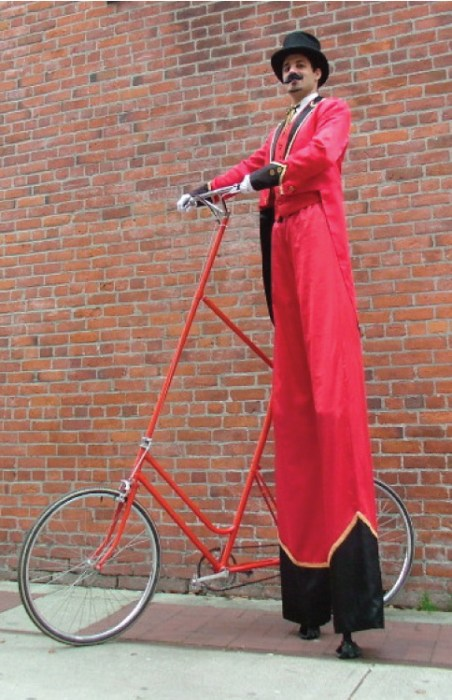 Ringmaster with Bicycle - Yes he rides it!