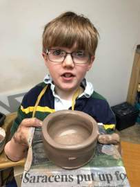 boy and pot