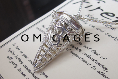 Om Cage Necklaces