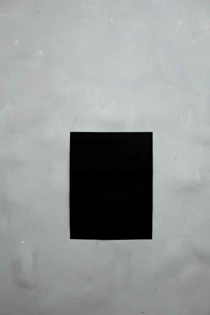 black empty poster on wall