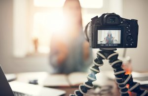 A screen shot of a woman making a video