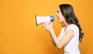 lady shouting through a loudhailer, communication trends 2020