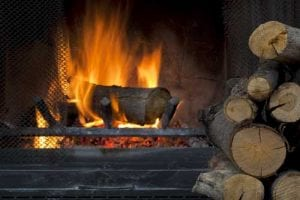 fire place with kiln dried logs on fire