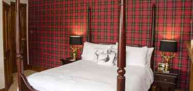 Mahogany four poster king size bed in the Findhorn room at Firhall Highland B&B