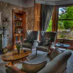 Harris tweed chairs and sofa in the guests lounge at Firhall Highland B&B in Scotland