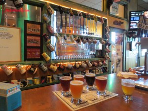 The bar at Wolf Creek Santa Clarita provides a window into the on-site brewing operations and is lined with patron's personalized ceramic beer mugs.