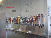 Beer taps line the wall.