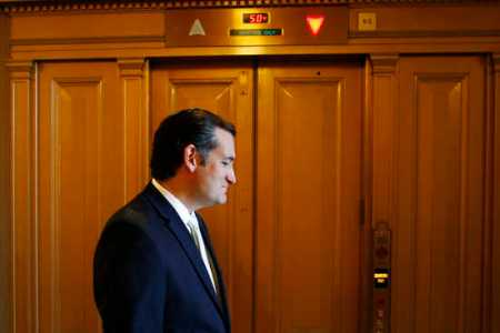 U.S. Senator Cruz departs after remarks as the body prepared to conduct a series of federal budget spending votes in Washington