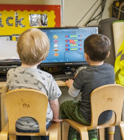 two children at computer desk