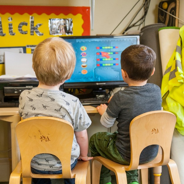 two children at computer desk