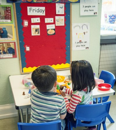 2 children playing at table 2