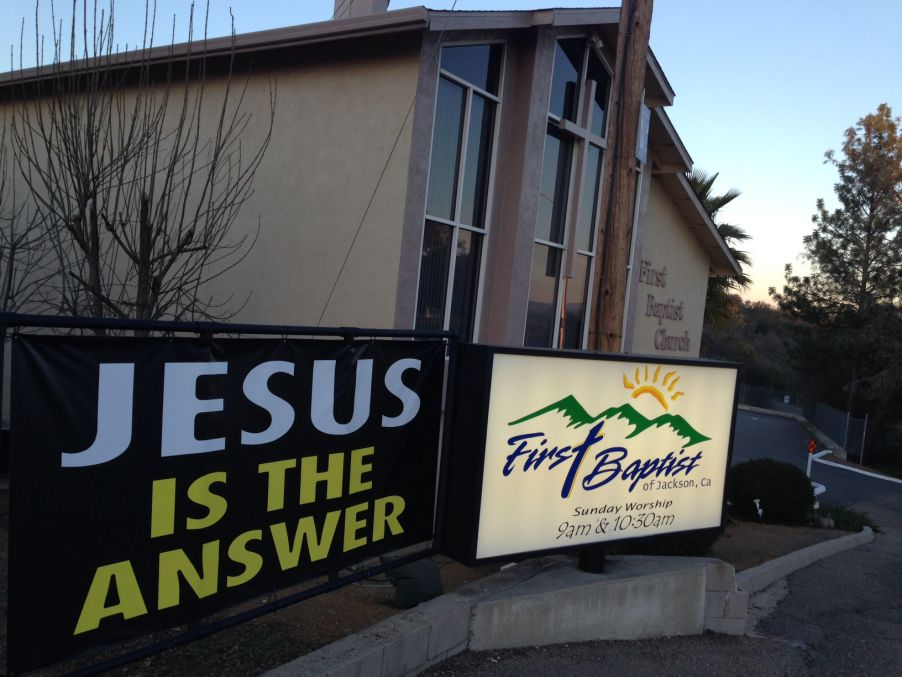 Front building Jesus is the Answer and lighted logo