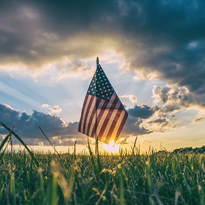 American flag and setting sun