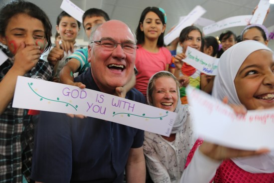 Revd Dr Roger Walton and Ms Rachel Lampard (President and Vice-President of the Methodist Church in Britain Conference 2016-18) spent time with children in the Husn Refugee Camp Child Forum. photo courtesy All We Can