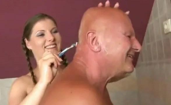 Shaving his grandfather's head