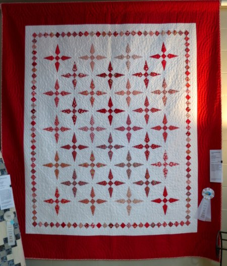 Thirty-Something Shades of Red by featured quilter
